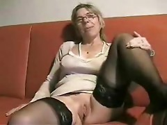 Milking mature with fastened tits