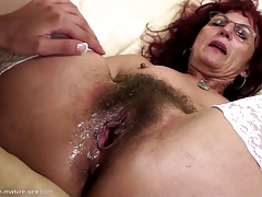 Hairy mom gets deep fisting from young girl