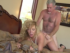 Horny granny rubs her tits before being fucked in a bed sex