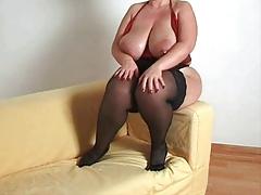 Busty plumper milf in stockings